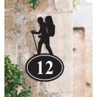 Hiking Iron House Number Sign on a Garden Wall