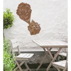 Floating House on Balloons Steel Wall Art  above a Wooden Table set