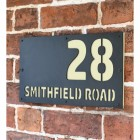 """Cream """"Smithfield"""" House Sign in Situ on the Wall"""