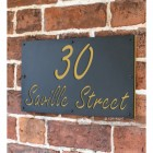 """Sand Yellow """"Saville"""" House Sign in Situ on the Wall"""