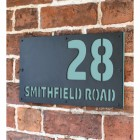 "Pastel Turquoise ""Smithfield"" House Sign in Situ on the Wall"