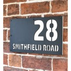 "White ""Smithfield"" House Sign in Situ on the Wall"