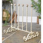 Wrought iron wellington boot rack finished in cream