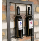Wine Bottles Being Held at the Top of the Wine Rack