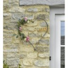 Iron Heart Hanging Wall Art in Situ on a Stone Wall