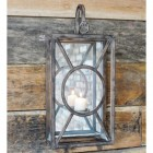 Wall mounted candle holder in natural iron