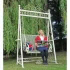 Lady sitting on garden swing seat