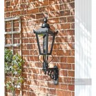Lantern on royal bracket mounted on brick wall