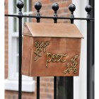 Antique Copper and Bass Celtic Design Post Box in Situ on a Fence