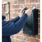 wall mounted post box with brass letter on lid