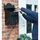 Post & parcel box on wall in use