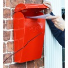 Red post box with lid lifted