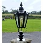 Black Hexagonal Pillar Light and Lantern Set in Situ on a Driveway