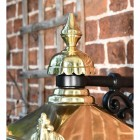 Close up of decorative finial on wall lantern