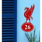 Liver Bird Iron House Number Sign in Situ on a Blue Wall