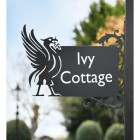 Black Liver Bird Wall Bracketed House Name Sign in Situ