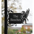 Liver Bird Wall Bracketed House Name Sign in Situ in a Front Garden