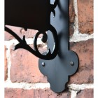 Close-up of the Fixing Holes on the Liver Bird Wall Bracketed House Name Sign