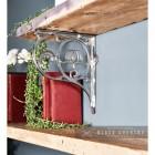 """Lotus Flower"" Bright Chrome Wall Bracket Holding up a Wooden Shelf"