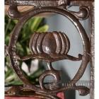 "Close-up of the ""Lotus Flower"" Design on the Iron Shelf Bracket"