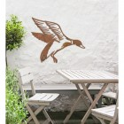 """Mallard"" Duck Wall Art in the Garden Above a Wooden Table and Chair Set"
