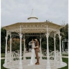 """Customer photograph of the """"Lady Leticia"""" Bandstand Gazebo in Use - Manor By the Lake"""