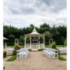 """""""Lady Leticia Dream Carousel"""" Bandstand Pavilion in Cream at the End of a Garden - Manor By The Lake"""
