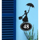 Mary Poppins Iron House Number Sign in Situ on a Blue Wall
