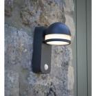 Matt Grey Adjustable LED Wall Light with PIR Sensor in Situ on a Stone Wall