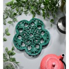Cast Iron Flower Petal Trivet in Green in Situ with Teapot