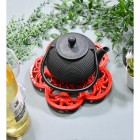 Red Cast Iron Flower Petal Trivet in Use with Teapot