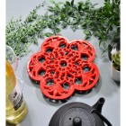 Red Cast Iron Flower Petal Trivet in Situ with Teapot