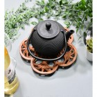 Rustic Cast Iron Flower Trivet in Use with Teapot