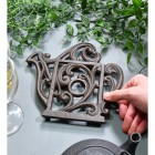 Rustic Kettle Shaped Cast Iron Trivet to Scale