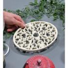Cream Cast Iron Oval Trivet to Scale