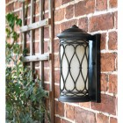 """Nightingale"" Traditional Flush Wall Lantern in Use on the Front of a House"