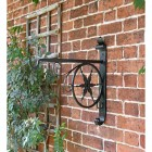 """Northern Star"" Hanging Basket Bracket in Situ on a Brick Wall"