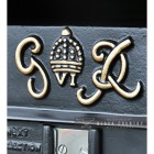 Close-up of the G.R Embossed Design on the Post Box