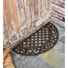 Cast Iron Door Mat with an Ornate Design in Situ by the Front