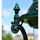 Ornate Finial On Antique Green Lamp Post