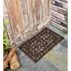 Black Rectangular Cast Iron Door Mat with an Ornate Design