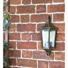 """Penley"" Flush Wall Light in Situ on a Garden Wall"