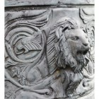Impressive lion detail on bronze chariot sculpture