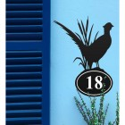 Pheasant Iron House Number Sign in Situ on a Blue Wall