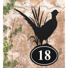 Pheasant Iron House Number Sign in Situ on a Rustic Wall