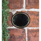 Polished Brass & Black Oval House Number Sign in Use Outdoors on a Wall