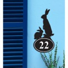 Rabbit Iron House Number Sign in Situ on a Blue Wall