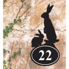 Rabbit Iron House Number Sign in Situ on a Rustic Wall