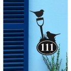 Robin Iron House Number Sign in Situ on a Blue Wall