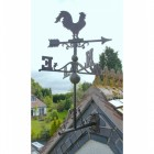 Rstic rooster weathervane on roof